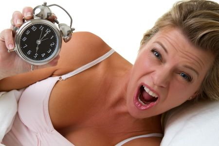 Screaming woman holding alarm clock Stock Photo - 7007429