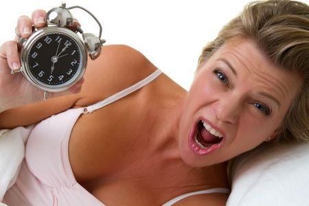 Screaming woman holding alarm clock Stock Photo - 7007429