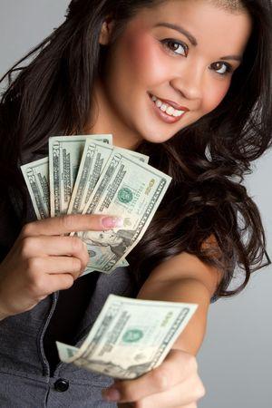Smiling woman holding money Standard-Bild
