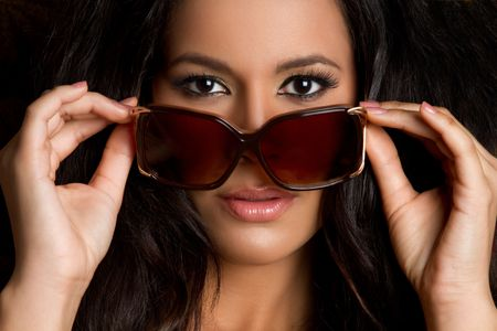 Beautiful latina woman wearing sunglasses