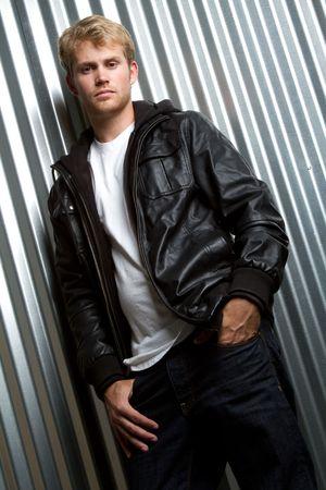 Young man wearing leather jacket Standard-Bild