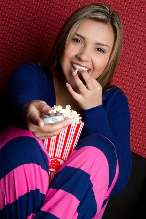 Girl watching tv eating popcorn Stock Photo - 7076944