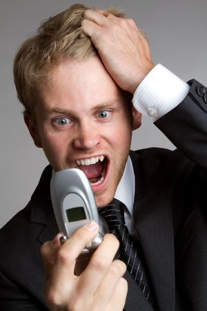 Business man yelling into phone Stock Photo - 7076943