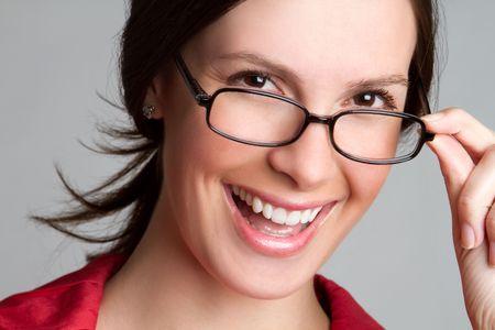 Beautiful smiling woman wearing glasses photo