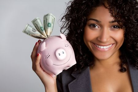 African american woman holding piggy bank Stock Photo - 7076951