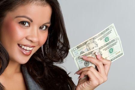 お金を持って美しい笑顔アジア女性