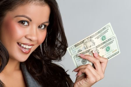 Beautiful smiling asian woman holding money Stock Photo