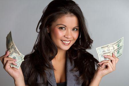 Beautiful smiling business woman holding money