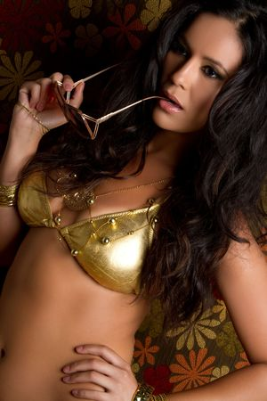 Beautiful latina woman wearing gold bikini Stock Photo - 7076963