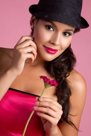 Pretty woman holding pink flower Stock Photo - 7076960