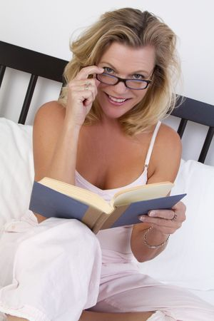 Woman reading in bed Stock Photo - 7115350