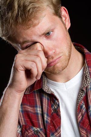 hand rubbing: Sad boy rubbing eyes LANG_EVOIMAGES