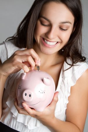 Girl saving money Stock Photo - 7115377