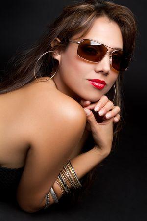 Beautiful latina woman wearing sunglasses Stock Photo - 7115379