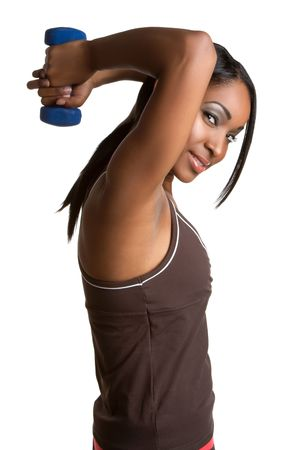 Exercising black woman lifting weights Stock Photo