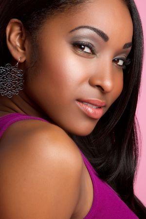 Pretty black woman portrait closeup LANG_EVOIMAGES