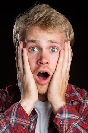 ショックを受けた若い男の驚いて 写真素材
