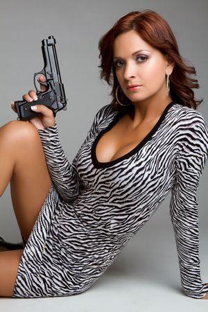 tight dress: Sexy woman holding gun