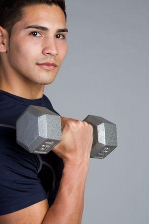 Fitness man lifting dumbbell Stock Photo - 9073843