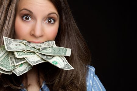 is astonished: Woman eating money