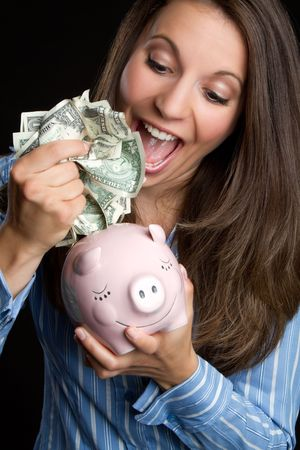 Woman saving money Stock Photo - 7525782