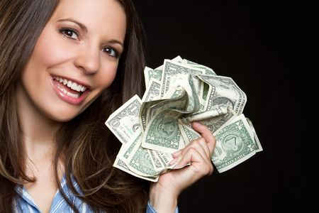greed: Woman holding money