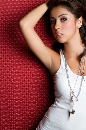 Pretty hispanic girl on red background