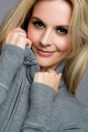 Pretty blond winter sweater woman