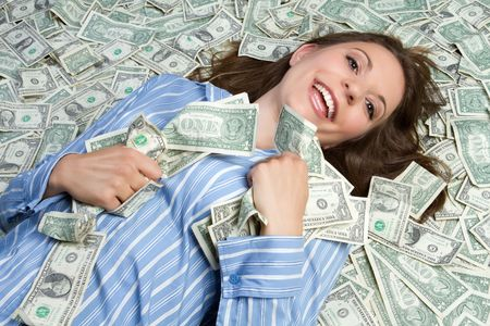 greedy: Woman laying in money