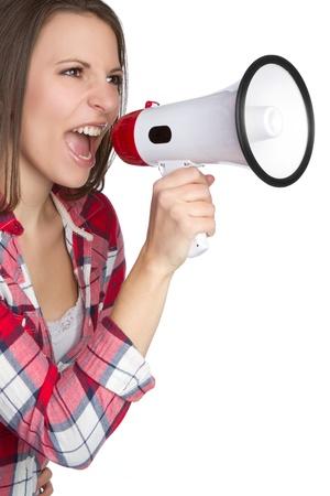 plaid shirt: Beautiful woman yelling into megaphone LANG_EVOIMAGES
