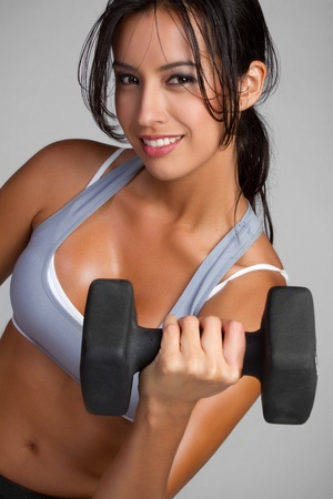 Beautiful smiling latina fitness woman