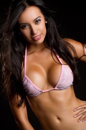 Beautiful latina woman wearing bikini