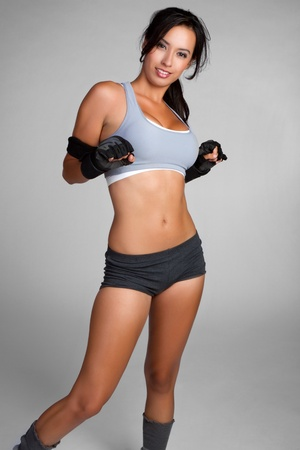 Smiling young athletic fitness woman Stock Photo - 9105741
