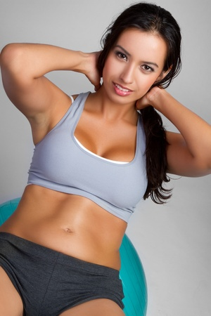 Beautiful latin fitness woman exercising Stock Photo - 9105749