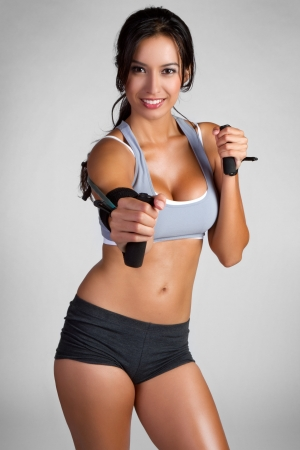 stretchy: Beautiful smiling fitness woman exercising