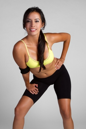 Beautiful hispanic fitness girl smiling