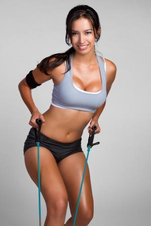 Beautiful healthy fitness woman exercising Standard-Bild