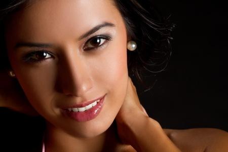Beautiful young latin woman smiling