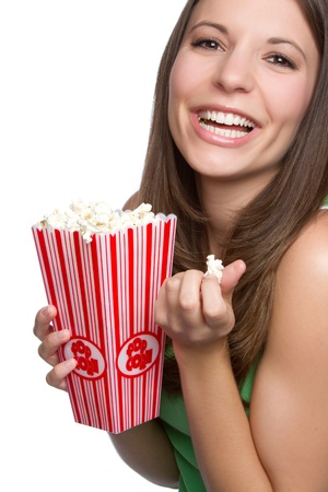 Pretty smiling girl eating popcorn Stock Photo - 9105768