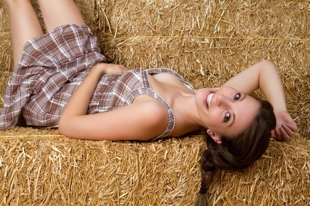 barn girls: Pretty country girl in hay LANG_EVOIMAGES
