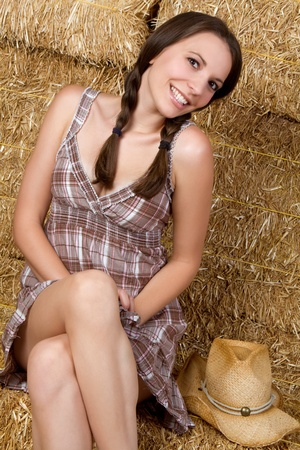 Country girl sitting in hay Stock Photo - 9105777