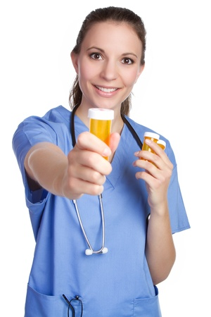 Nurse holding medicine pill bottle Stock Photo