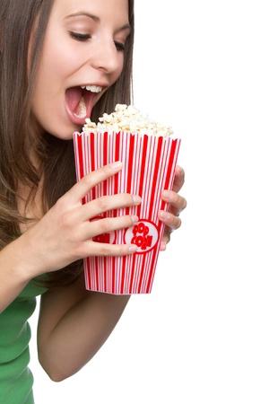 Beautiful hungry girl eating popcorn Stock Photo - 9105762