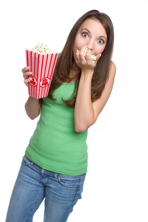 Isolated teenage girl eating popcorn