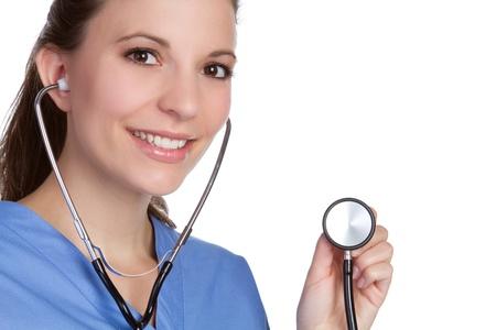 Beautiful smiling nurse holding stethoscope Stock Photo