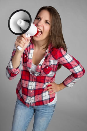 Beautiful megaphone bullhorn woman yelling Stock Photo - 9256707