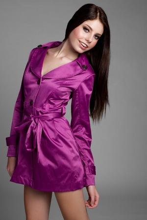 Young woman wearing purple raincoat Stock Photo - 9256686