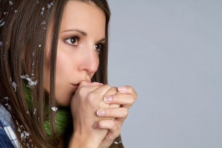 Cold woman blowing on hands Stock Photo - 9397195