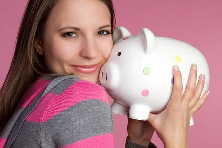 piggybanks: Young woman holding piggy bank LANG_EVOIMAGES