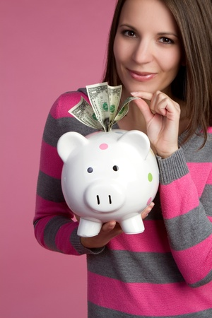 Piggy bank girl taking money Stock Photo - 9397186